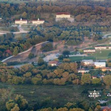An aerial view of campus showing the tennis courts, domes, housing, and main campus buildings