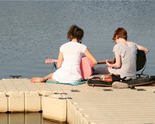 Students playing guitar at the Fairfield reservoir