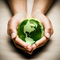 hands holding a green glass globe