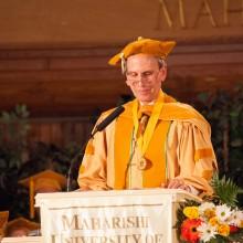 Dr. Bob Roth presenting at graduation