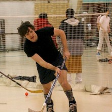Students playing hockey in the Rec Center