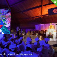 One of Jim's favorite photos from his commencement address; unveiling his black light painting