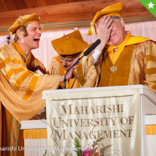 One of Jim's favorite photos from his commencement address; playing jokes on the University President
