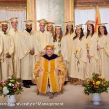 Jim Carrey Poses with MUM Graduates