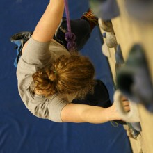 Student climbing the rock wall in the Rec center