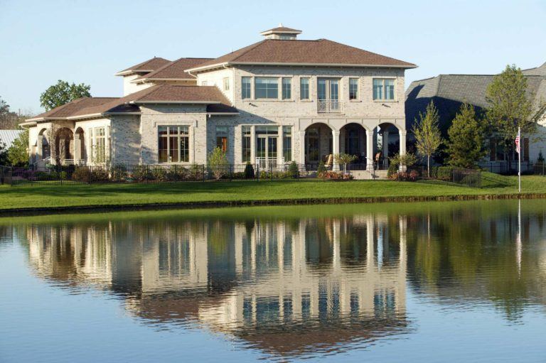 image of beautiful Vastu home, with lake in foreground
