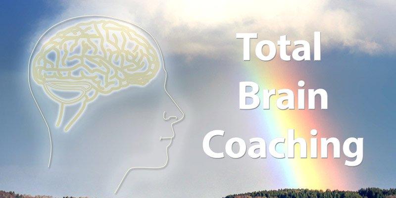 Total Brain Coaching * Image of a human head and glowing brain